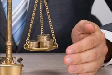 A equivocada responsabilização criminal objetiva nos crimes tributários: Um grave desrespeito ao direito de defesa.